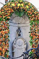Manneken Pis, a small statue of a peeing boy, is the mascot of Brussels Belgium.