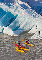 Tourists kayak by icebergs in Nellie Juan Lagoon, Prince William Sound, Chugach National Forest, Kenai Peninsula, southcentral, Alaska.