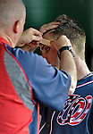 16 May 2012: Washington Nationals outfielder Bryce Harper has a bandage applied to his forehead by trainer Mike McGowan prior to a game against the Pittsburgh Pirates at Nationals Park in Washington, DC. The Nationals defeated the Pirates 7-4 in the first game of their 2-game series. Mandatory Credit: Ed Wolfstein Photo