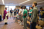 Mar. 18, 2015; Team chaplain Rev. Pete McCormick, C.S.C. celebrates Mass with the Men's Basketball team the evening before the second round of the 2015 NCAA Tournament. (Photo by Matt Cashore/University of Notre Dame)