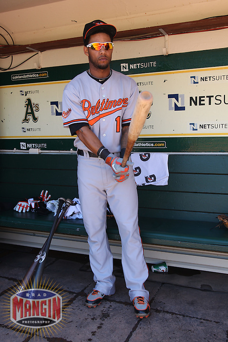 OAKLAND, CA - AUGUST 17:  Robert Andino #11 of the Baltimore Orioles gets ready in the dugout before the game against the Oakland Athletics at O.co Coliseum on August 17, 2011 in Oakland, California. Photo by Brad Mangin