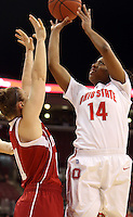 Ohio State Buckeyes guard Ameryst Alston (14) goes for a layup while defended by Indiana Hoosiers guard Andrea Newbauer (11) in the first half of their game at the Value City Arena in Columbus, Ohio on January 17, 2013. (Columbus Dispatch photo by Brooke LaValley)