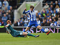 Brighton &amp; Hove Albion's Solly March (R) is tackled by Wigan Athletic's Max Power (L)<br /> <br /> Brighton 2 - 1 Wigan<br /> <br /> Photographer David Horton/CameraSport<br /> <br /> The EFL Sky Bet Championship - Brighton &amp; Hove Albion v Wigan Athletic - Monday 17th April 2017 - American Express Community Stadium - Brighton<br /> <br /> World Copyright &copy; 2017 CameraSport. All rights reserved. 43 Linden Ave. Countesthorpe. Leicester. England. LE8 5PG - Tel: +44 (0) 116 277 4147 - admin@camerasport.com - www.camerasport.com