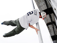 Breakdancer standing on a streetlamp
