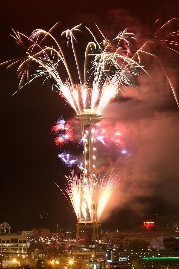 Fireworks launched from the Seattle Space Needle at night in celebration of the 2004 New Year's Day, Seattle, Washington