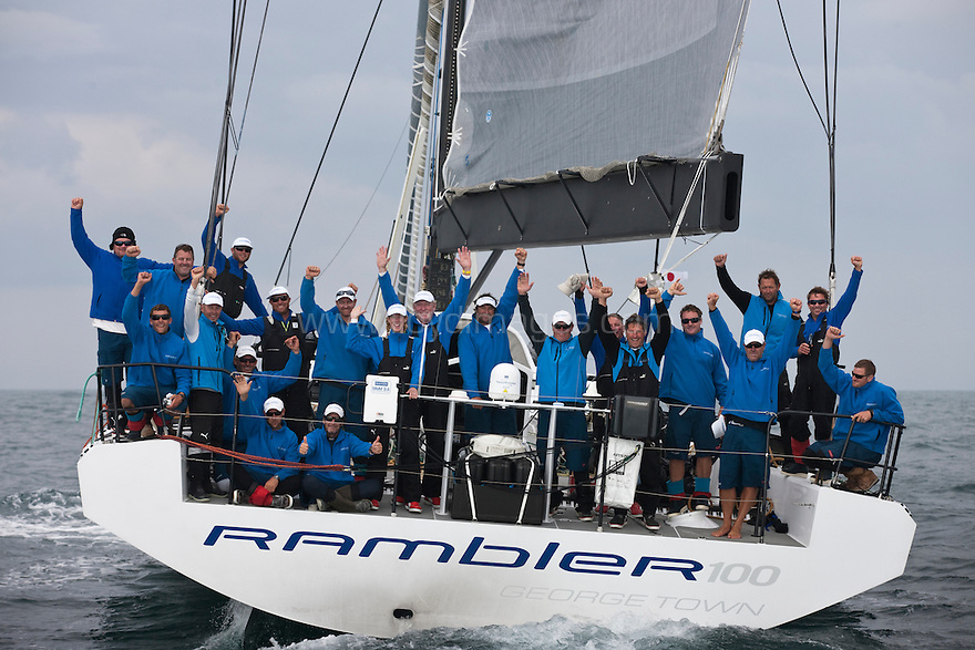 Pictures of the Rambler100 crossing the finish line of the Transatlantic Race 2011 and claiming line honours. The Lizard. Cornwall. UK..Credit: Lloyd Images