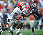 Georgia running back Isaiah Crowell (1) runs past Ole Miss' Charles Sawyer (3) at Vaught-Hemingway Stadium in Oxford, Miss. on Saturday, September 24, 2011. Georgia won 27-13.