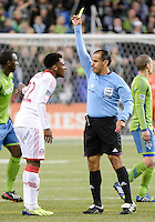 November, 2013: CenturyLink Field, Seattle, Washington:  Portland Timbers defender/midfielder Rodney Wallace (22) argues with the referee after getting a yellow card as the Portland Timbers defeat  the Seattle Sounders FC 2-1 in the Major League Soccer Playoffs semifinals Round.