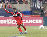 Chicago Fire defender Jalil Anibaba (6) clears the ball. In a Major League Soccer (MLS) match, the New England Revolution (blue) defeated Chicago Fire (red), 1-0, at Gillette Stadium on October 20, 2012.