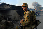 An Australian Peacekeeper is part of a patrol sent in to secure a burnt out area in Calico, near the Old Market area of Dili, as continual violence, looting and arson disrupt Dili. There is some confusion in Dili as to whether the violence is the result of ethnic tensions, or localised gang violence. 05/06/06