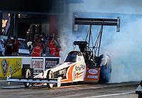 Sep 13, 2013; Charlotte, NC, USA; NHRA top fuel dragster driver Clay Millican during qualifying for the Carolina Nationals at zMax Dragway. Mandatory Credit: Mark J. Rebilas-