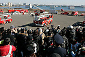 TOKYO - JANUARY 06: Firefighters demonstrate rescue operations during the New Year's fire review conducted by the Tokyo Fire Department at Tokyo Big Sight on January 6, 2010 in Tokyo, Japan. The annual event, featuring various demonstrations of the latest firefighting and emergency rescue techniques, aims to promote the prevention of fire and disaster. About 2,700 professional firefighters and members of community-based fire companies in Tokyo and 137 fire vehicles, helicopters and ships were mobilized for the annual demonstration. (Photo by Laurent Benchana/Nippon News)