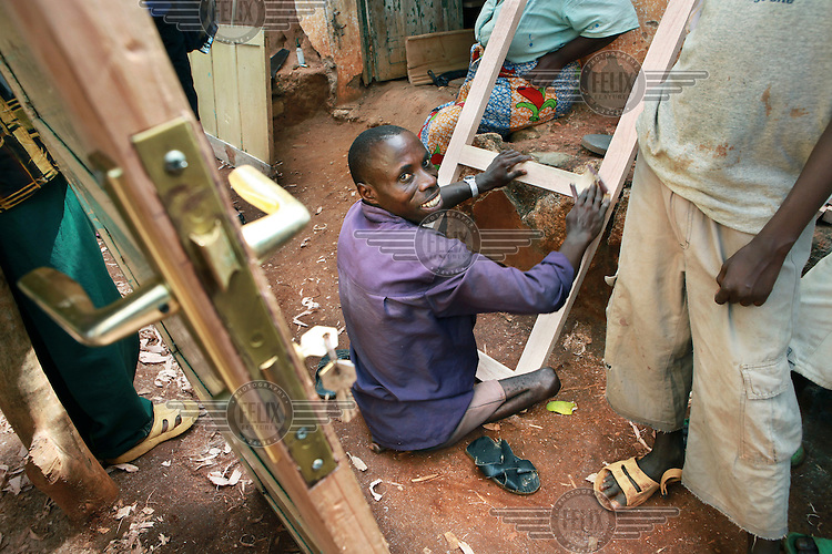 35 year old Jonathan Bigirimana has had polio since he was six years old. He is married and has seven children and now works at a joinery run by the Association pour l'Auto-Developpement des Personnes Handicapees, an association for the development of people living with a disability. They also assist disabled people with agricultural work and organise literacy courses. 10 people work in the workshop to produce school benches, cupboards, beds and seats.