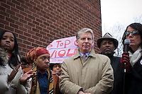 """Manhattan District Attorney Cyrus Vance Jr., center, at the """"Too Many Victims"""" march and rally in Harlem in New York on Sunday, January 8, 2012 on the one year anniversary of the Tucson shooting of  U.S. Representative Gabrielle Giffords and other victims. The event remembered all victims of gun violence with the lighting of candles. (© Frances M. Roberts)"""