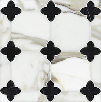 Greta, a stone water jet mosaic, shown in Calacatta Tia and nero Marquina, is part of the Ann Sacks Beau Monde collection sold exclusively at www.annsacks.com