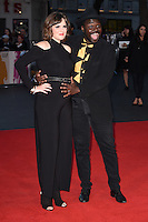 LONDON, UK. October 16, 2016: Babou Ceesay &amp; Anna Ceesay at the London Film Festival 2016 premiere of &quot;Free Fire&quot; at the Odeon Leicester Square, London.<br /> Picture: Steve Vas/Featureflash/SilverHub 0208 004 5359/ 07711 972644 Editors@silverhubmedia.com