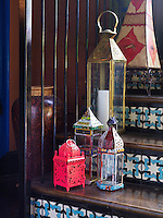 A small bright pink lantern is the focal point of this collection on the stairs