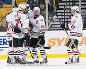 Anthony Bitetto (Northeastern - 7), Tyler McNeely (Northeastern - 94) and Wade MacLeod (Northeastern - 19) celebrate Reid's goal. - The Northeastern University Huskies defeated the Harvard University Crimson 4-0 in their Beanpot opener on Monday, February 7, 2011, at TD Garden in Boston, Massachusetts.