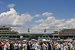 Race fans watch the jumbotron at Churchill Downs, home to the Kentucky Derby in Louisville, Kentucky.