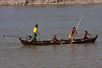 Myanmar, Burma, near Bagan.  Men Going Upriver in the Ayeyarwady (Irrawaddy) River.