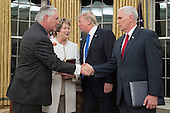 Rex Tillerson (L) shakes hands with US Vice President Mike Pence (R), as US President Donald J. Trump (2-R) speaks with Tillerson's wife Renda St. Clair (2-L), after Tillerson was sworn-in as US Secretary of State, in the Oval Office of the White House in Washington, DC, USA, 01 February 2017. Tillerson was confirmed by the Senate, 01 February, in a 56-to-43 vote to become the nation's 69th Secretary of State.<br /> Credit: Michael Reynolds / Pool via CNP