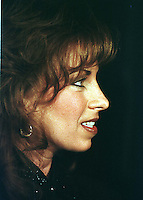 Paula Jones appears at a press conference called by Abe Hirschfeld where she received a check for one million dollars to settle her sexual harassment lawsuit against United States President Bill Clinton at the Mayflower Hotel in Washington, DC on 31 October, 1998.<br /> Credit: Ron Sachs / CNP /MediaPunch