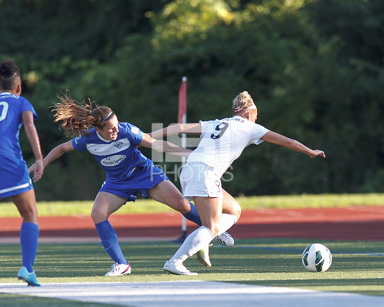 Boston Breakers midfielder Heather O'Reilly (9)  reaches for the ball. In a National Women's Soccer League (NWSL) match, Boston Breakers (blue) defeated FC Kansas City (white), 1-0, at Dilboy Stadium on August 10, 2013.