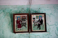 Faded composite pictures of Dang Van Sanh (R) and his wife Nguyen Thi Thin hang on the wall of the family house in Le Son Bac village, north of Danang April12, 2015. Dang Van Sanh was directly sprayed by the Agent Orange while fighting in jungle during the Vietnam War and later died of throat cancer. He had four children of which two died just after the birth. His son Dang Van Son survived but it's disabled as well as his granddaughter, a third generation Agent Orange victim. Family and officials blame the toxic chemical defoliant for their health condition.   REUTERS/Damir Sagolj