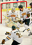 5 February 2011: University of Vermont Catamount goaltender Rob Madore, a Junior from Pittsburgh, PA makes a third period save against the Providence College Friars at Gutterson Fieldhouse in Burlington, Vermont. Madore made 31 saves for Vermont, moving the team ahead of Providence in league standings as the Catamounts defeated the Friars 7-1 in the second game of their weekend series. Mandatory Credit: Ed Wolfstein Photo