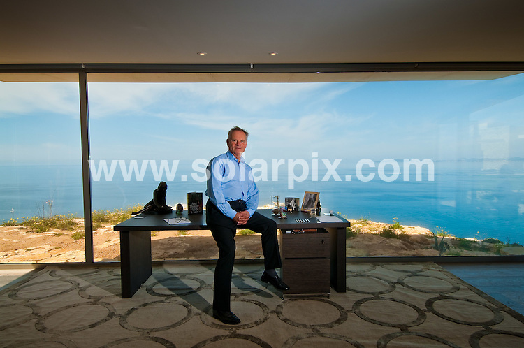**ALL ROUND EXCLUSIVE PICTURES FROM SOLARPIX.COM**.**WORLDWIDE SYNDICATION RIGHTS**.Author Jeffrey Archer pictured at his Mallorca home, Spain. 16 April 2010..This pic: Jeffrey Archer pictured in the writing room of his Mallorca home. The room has a 180 degree view of the Mediterranean and the Palma shoreline. The 2 hour sand timer on his desk counts down a writing session...JOB REF: 11112 BHY DATE: 16_04_2010.**MUST CREDIT SOLARPIX.COM OR DOUBLE FEE WILL BE CHARGED**.**MUST AGREE FEE BEFORE ONLINE USAGE**.**CALL US ON: +34 952 811 768 or LOW RATE FROM UK 0844 617 7637**