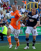 Gary Taylor-Fletcher, Blackpool FC demonstrates calm and ball skill as he clears his lines under pressure from Alan Dunne, Millwall FC - Millwall vs Blackpool - NPower Championship Football at the New Den, London - 18/08/12 - MANDATORY CREDIT: Ray Lawrence/TGSPHOTO - Self billing applies where appropriate - 0845 094 6026 - contact@tgsphoto.co.uk - NO UNPAID USE.