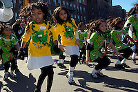 Students from PS 59 perform their dance routine at the Sunnyside Queens St. Patrick's Day Parade on March 5, 2006. Started as an alternative to the NYC parade, the organizers have endeavoured to make the parade inclusive allowing gays and lesbians to march who were banned from the NYC parade. (© Richard B. Levine)
