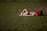 A woman takes a sunbath during the beginning of spring season at Central park in New York, United States. 20/03/2012.  Photo by Eduardo Munoz Alvarez / VIEWpress.