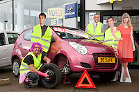 Pictured at Bristol Street Motors Mansfield is Service manager David Ince checking the car for winter safety with a few brightly dressed 'celebrities'