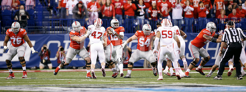 Ohio State Buckeyes offensive lineman Darryl Baldwin (76), Ohio State Buckeyes offensive lineman Pat Elflein (65), Ohio State Buckeyes offensive lineman Jacoby Boren (50), Ohio State Buckeyes offensive lineman Billy Price (54) and Ohio State Buckeyes offensive lineman Pat Elflein (65) against Wisconsin Badgers in the 2014 Big Ten Football Championship Game at Lucas Oil Stadium in Indianapolis, Ind. on December 6, 2014.  (Dispatch photo by Kyle Robertson)