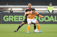 Houston Dynamo forward Brian Ching (25) shields the ball against D.C. United defender Robbie Russell (3) D.C. United defeated The Houston Dynamo 3-2 at RFK Stadium, Saturday April 28, 2012.