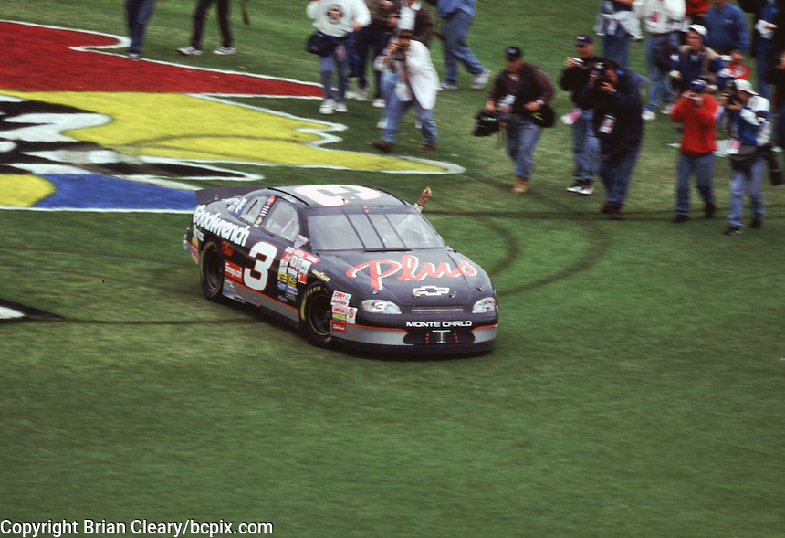 Dale Earnhardt celebrates with donuts in the grass at Daytona International Speedway after winning the 1998 Daytona 500 in February 1998.(Photo by Brian Cleary/www.bcpix.com)