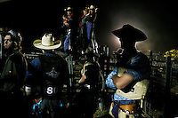 Bull riders are pictured waiting to compete at the Scone horse week rodeo, Saturday, May 12, 2007. Rodeo is an integral part of rural Australian lifestyle and competitors travel great distances to compete on the circuit. (AAP Image/James Horan) NO ARCHIVING