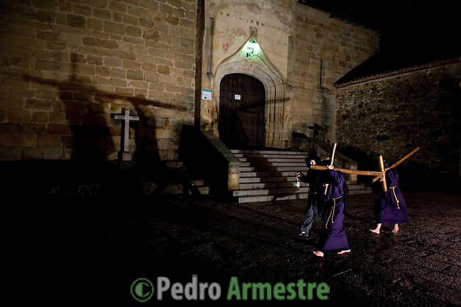Empalaos make the steps of the 'Via Crucis', marking the Stations of the Cross, during the night of Maundy Thursday while bound by rope to a crucifix as an act of penance and to honour a promise made to the Empalaos Brotherhood and the Christ of Vera Cruz, in the town of Valverde de la Vera. The process of dressing the Empalao in the traditional costume is taken with great care, with the family and dressers paying attention to ensure that no harm is caused to the penitent and that they are aided in their recovery, including being massaged and rubbed with rosemary alcohol. Many Spanish towns and villages retain such rites and religious traditions, many passed down from medieval times, across the Easter weekend. (c) Pedro ARMESTRE