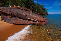 Lake Superior waves roll onto a sand beach on Bear Island in the Apostle Islands National Lakeshore near Bayfield, Wis.