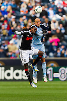 Keon Daniel (26) of the Philadelphia Union  goes up for a header with Aurelien Collin (78) of Sporting Kansas City. Sporting Kansas City defeated the Philadelphia Union 3-1 during a Major League Soccer (MLS) match at PPL Park in Chester, PA, on March 2, 2013.