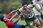 Fritz Lee gets a hand in the face as he tries to drag Roger Hasiate to ground. Counties Manukau Premier Club Rugby game between Manurewa and Ardmore Marist played at Mountfort Park, Manurewa on Saturday June 19th 2010..Manurewa won the game 27 - 10 after leading 15 - 5 at halftime.