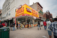 Fast food restaurant Texas Chicken & Burgers in Harlem in New York on Saturday, June 11, 2016. (© Richard B. Levine)