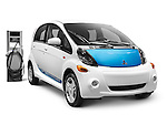 2012 Mitsubishi i MiEV electric car and a charging station isolated on white background with clipping path