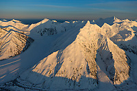 Aerial view of the Alaska range mountains. Mount Deception (left) Mount Brooks (center) and Silverthorne mountain in the right distance. Brooks glacier on the left, Denali National Park, interior, Alaska.