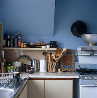 The corner of this small kitchen is packed with utensils and spices