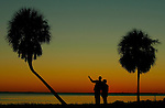 Residents watch the sunset at Shell Point in coastal Wakulla County south of Tallahassee, Florida.    (Mark Wallheiser/TallahasseeStock.com)