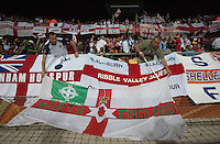 Two England fan place a supporters flag inside the Royal Bafokeng Stadium before the 2010 World Cup first round match between USA and England in Rustenberg, South Africa on Saturday, June 12, 2010.