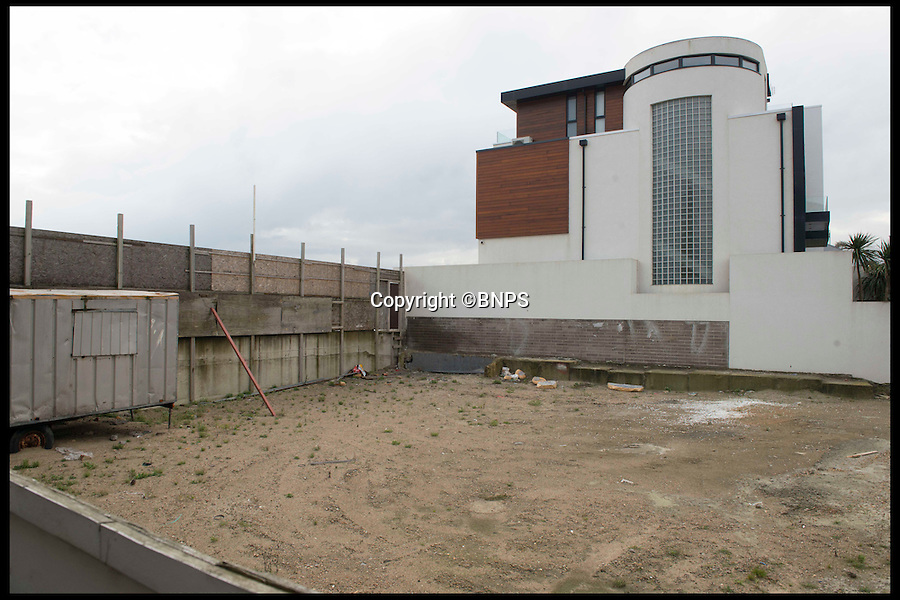 BNPS.co.uk (01202 558833)<br /> Pic: LauraDale/BNPS<br /> <br /> The plot in its current state.<br /> <br /> A narrow empty plot of land in the world-renowned Sandbanks area is on the market for &pound;6.25million.<br /> <br /> The piece of land is worth &pound;2m more now its empty than it was when the owner bought it with two semi-detached houses on it.<br /> <br /> The area in Dorset, often called Millionaire's Row, is said to be the fourth most expensive place in the world to live and this plot is one of the few left to redevelop.