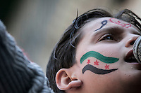 A Syrian youth chants anti government slogans during a demostration after friday prayers in the Bustan Al Qasr district of Aleppo, Syria.